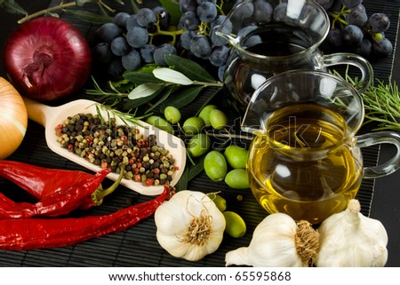 Extra virgin olive oil and balsamic vinegar with mediterranean food ingredients - stock photo