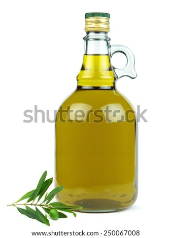 Extra virgin olive oil in glass bottle with green olive branch isolated on white background. - stock photo