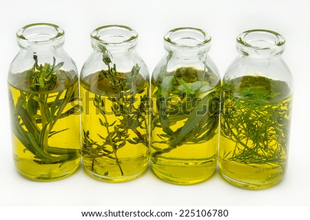 Extra virgin olive oil surrounded by freshly harvested olives - stock photo