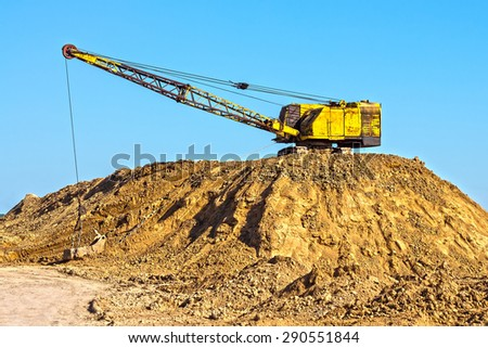 Extraction of clay for brick production shovels - stock photo