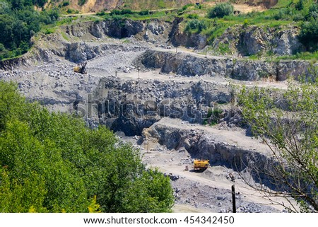 Extraction of mineral resources in the granite quarry - stock photo