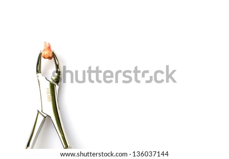 Extraction of tooth with Dental tools and equipment on white background - stock photo