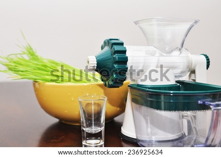 extractor with wheatgrass - stock photo