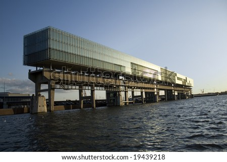 Extraordinary office building (kraanspoor) build above water on a former crane track