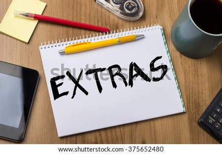 EXTRAS - Note Pad With Text On Wooden Table - with office  tools - stock photo
