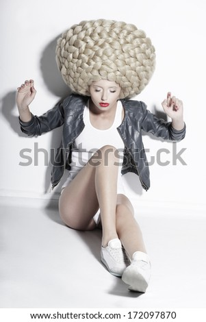 Extravagance. Eccentric Blonde Hair Model with Fantastic Updo Coiffure - stock photo