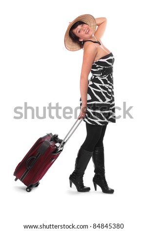 Extravagant young woman going on vacation with her suitcase.