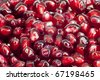Extreme close up background of a red juicy ripe pomegranate fruit seeds - stock photo