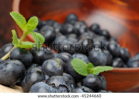 Extreme close-up image of berries with bowl in background