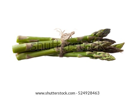 Extreme close-up image of fresh asparagus on white background