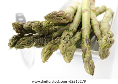 Extreme close-up image of fresh asparagus with white background - stock photo
