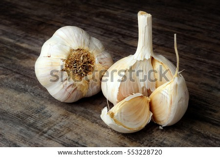 Extreme close-up image of garlic placed on kitchen counter-top