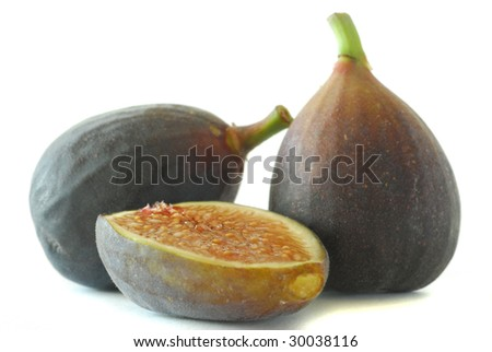 Extreme close-up image of purple figs studio isolated on white
