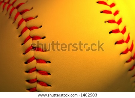 Extreme close up of a baseball in special lighting condition with selective focus on the left part. - stock photo