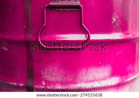 Extreme close up of a tin of pink paint. - stock photo