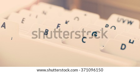 Extreme close up of an alphabetical organizer tray used to store business cards - stock photo