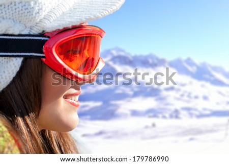 Extreme close up of female skier with goggles in mountains. - stock photo