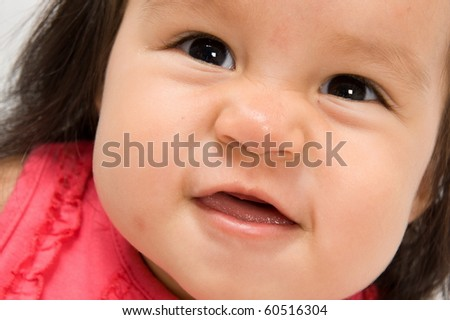 Extreme Close-up of happy asian baby . - stock photo