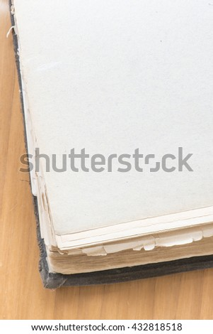 Extreme close up of old vintage book with blank page.  - stock photo