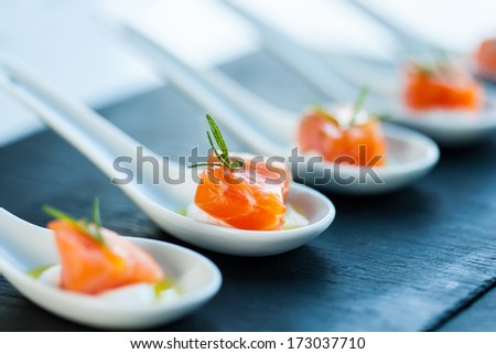 Extreme close up of smoked salmon morsel catering. - stock photo