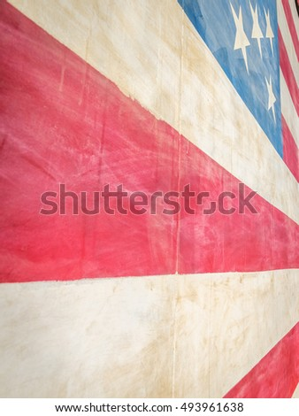 Extreme close-up of stars and red and white stripes of one story tall painted American flag on wall.  Forced perspective. / American Flag Abstract I