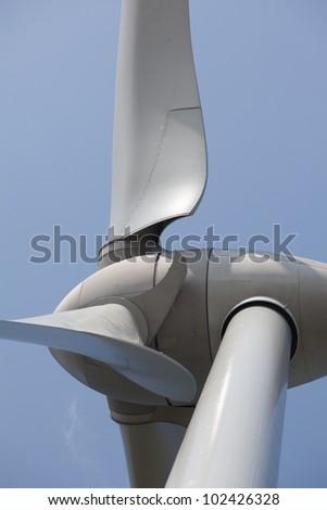 Extreme close up of wind turbine - stock photo