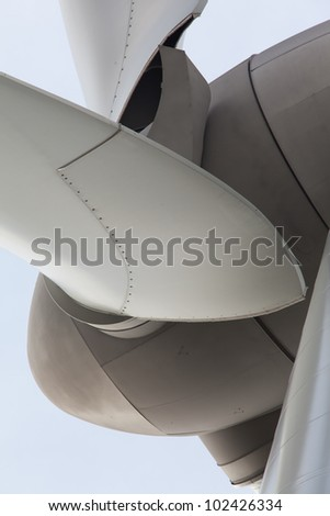 Extreme close up of wind turbine - stock photo