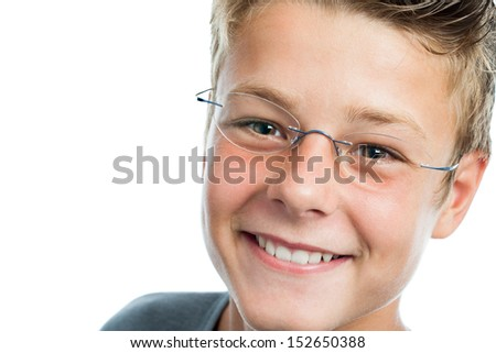 Extreme close up portrait of teen boy wearing glasses.isolated on white.