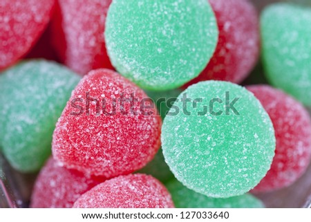 Extreme close-up shot of heap of red and green sugar candy. - stock photo