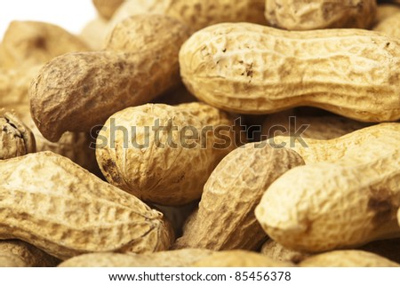 extreme closeup of a delicious peanuts stack - stock photo