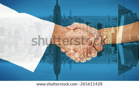 Extreme closeup of a doctor and patient shaking hands against room with large window looking on city - stock photo