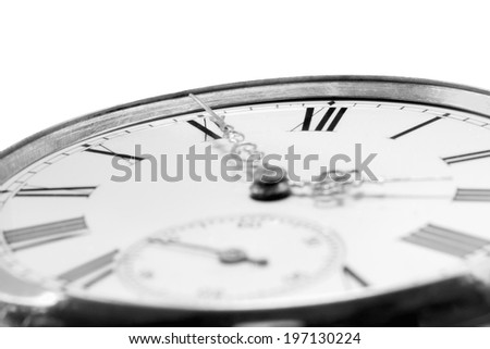 Extreme closeup of an antique golden pocket watch isolated on white background, monochrome. Concept of time, past or deadline - stock photo