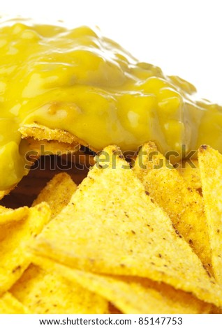 extreme closeup of nachos plate on white background