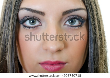 extreme closeup of natural and casual looking attractive green eyes young woman face with makeup - stock photo