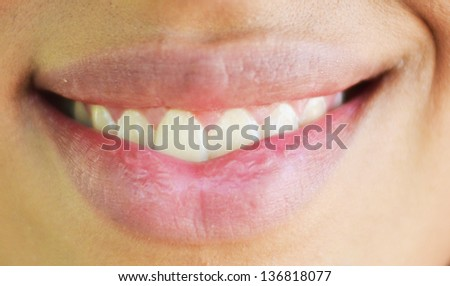 Extreme closeup of woman mouth smiling