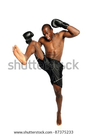 Extreme Fighting Athete kicking isolated on a white background - stock photo