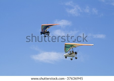 Extreme flight on delta plane in a blue sky - stock photo
