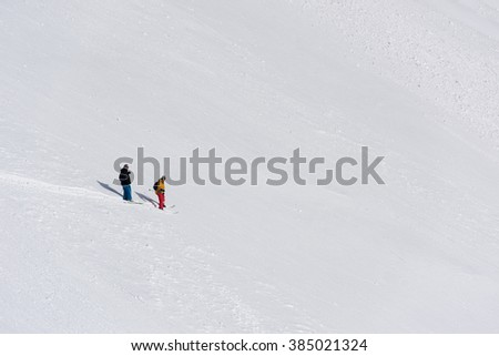 extreme freeride skier skiing on fresh powder snow in downhill at winter mountains - stock photo
