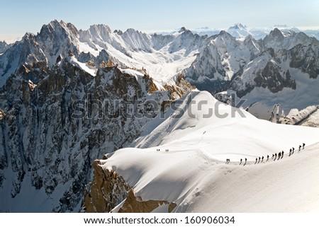 Extreme hiking in European Alps. - stock photo