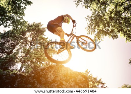 Extreme jump with a trial bicycle. concept about downhill and mountain bike - stock photo