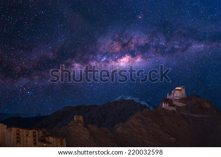 Extreme long exposure image showing nightsky with Namgyal Tsemo Gompa, main buddhist monastery centre in Leh, Ladakh, India  - stock photo
