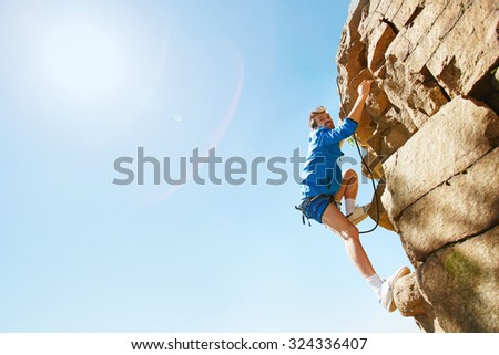 Extreme lover climbing on top of rocky mountain