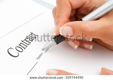 Extreme Macro Close up of female hand signing a contract. - stock photo