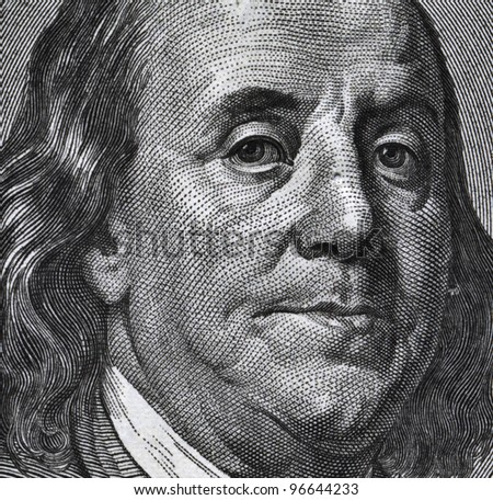 Extreme macro of 100 dollar bill with Benjamin Franklin portrait - stock photo