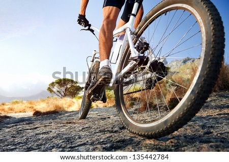 Extreme mountain bike sport athlete man riding outdoors lifestyle trail - stock photo