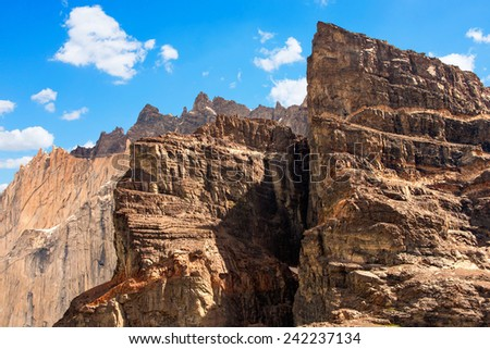 Extreme Rocky mountain peaks against blue sky. - stock photo
