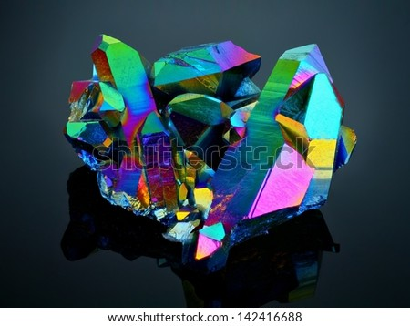 Extreme sharp Titanium rainbow aura quartz crystal cluster stone taken with macro lens stacked from many shots into one very sharp image. - stock photo