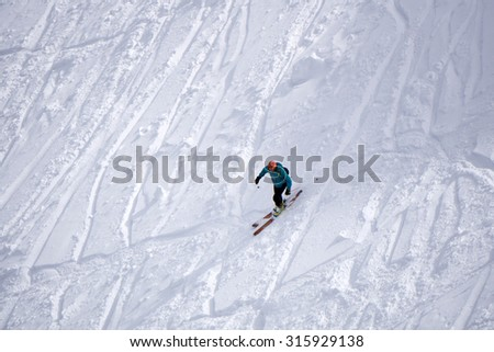 Extreme ski freeride, tracks on a slope. Skier in deep powder - stock photo