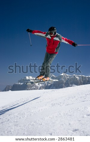 extreme ski jumper jumping high - winter mountain action scene