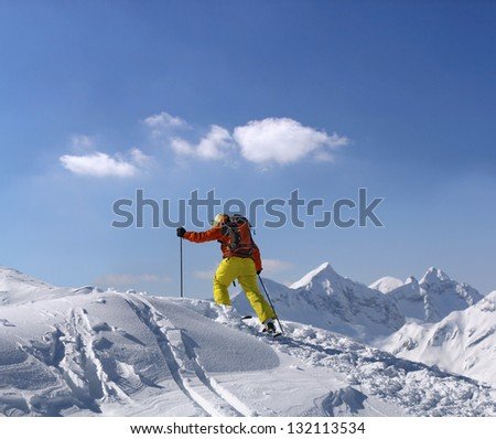 Extreme skier climbs to the top of the mountain